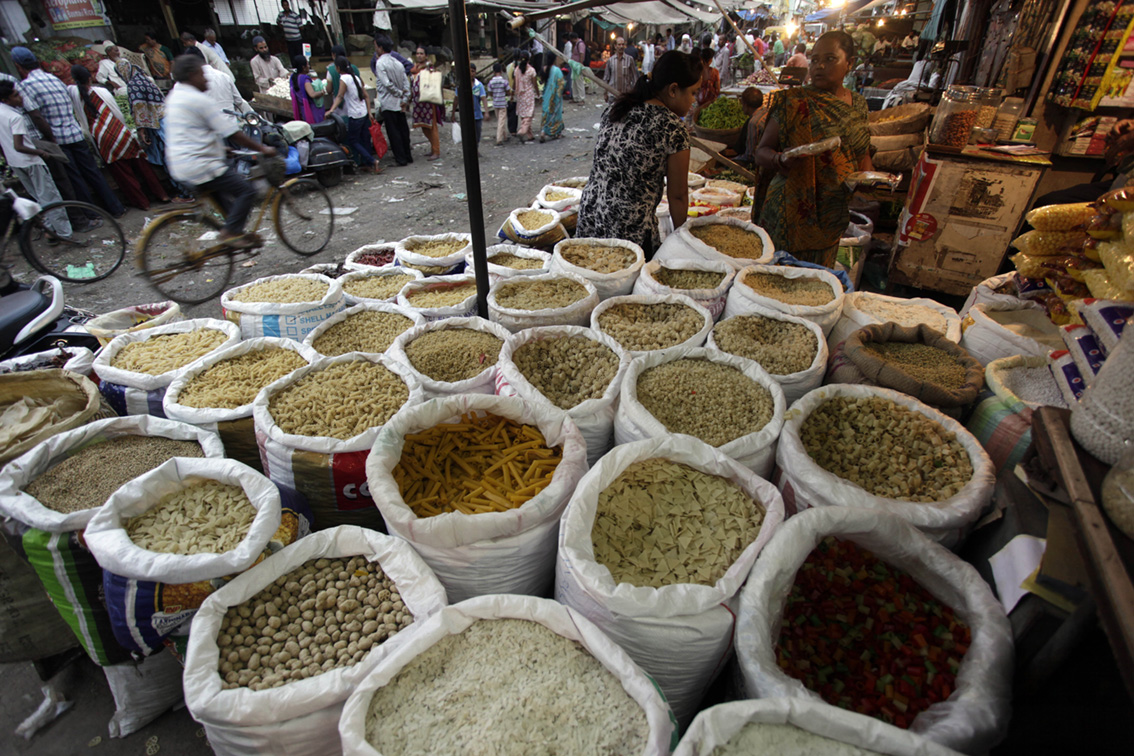 Emerging market - Indians shop at a market in Ahmadabad, India, AP